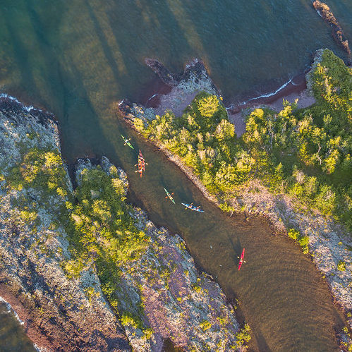 Sea Kayakers explore the waterways of Lake Superior in the Keweenaw Peninsula